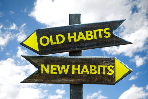 old-habits-new-habits-signpost-with-sky-background
